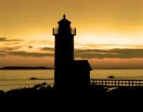 заход солнца померанца маяка Стоковое фото RF