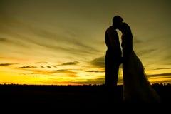 заход солнца поцелуя Стоковое Изображение RF