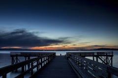 заход солнца пристани Стоковая Фотография