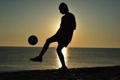 заход солнца футбола Стоковая Фотография