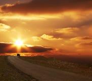 заход солнца дороги к Стоковые Изображения RF
