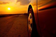 Заход солнца автомобиля Стоковые Изображения