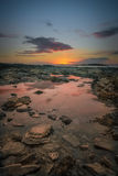 Заход солнца бассейна утеса Стоковое Изображение RF