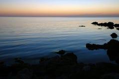 Заход солнца вечера на пляже Стоковое фото RF