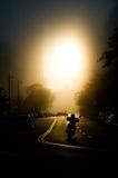 Заход солнца всадника мотоцикла Стоковая Фотография