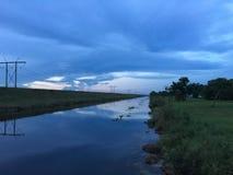 Заход солнца в болотистых низменностях Стоковое Изображение