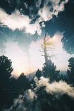 Заход солнца в горах, удваивает подверганный действию Стоковая Фотография