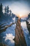 Заход солнца в горах, удваивает подверганный действию Стоковое Изображение