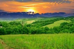 Заход солнца в горах Стоковые Фото