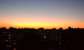 Заход солнца в городе Стоковые Фото