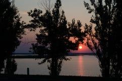 Заход солнца в конце дня Стоковая Фотография