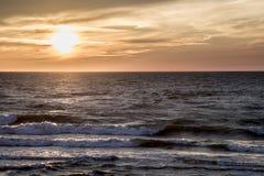 Заход солнца в море Стоковое Изображение
