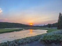 Заход солнца в национальном парке Йеллоустона Стоковая Фотография RF