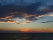 Заход солнца в океане Стоковое Изображение