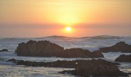 Заход солнца в океан Стоковое Изображение