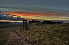 Заход солнца в полях Стоковая Фотография