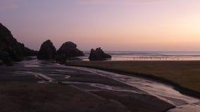 Заход солнца в пляжном комплексе Totoritas Лимы, Перу Стоковое Изображение