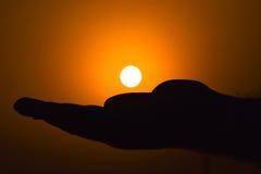Заход солнца в руке Стоковые Изображения RF