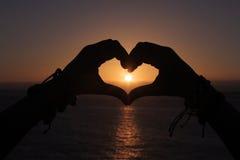 Заход солнца в сердце Стоковые Изображения RF