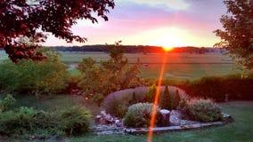 Заход солнца в сельской местности Стоковая Фотография