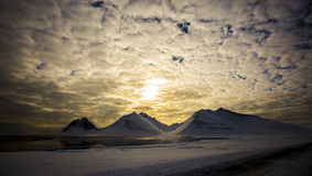 Заход солнца в снежном ландшафте, Исландии Стоковые Изображения RF