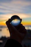Заход солнца в хрустальном шаре стоковое фото rf