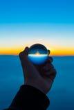 Заход солнца в хрустальном шаре стоковая фотография rf