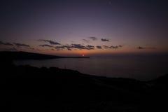 Заход солнца в Oia Santorini Греции Стоковое фото RF
