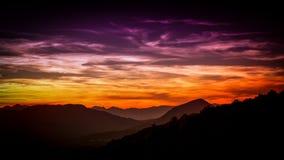 Заход солнца гористых местностей Стоковая Фотография