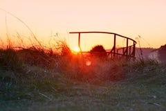Заход солнца Дувра через сталь и природу Стоковые Изображения