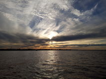 заход солнца лета реки вечера стоковое изображение rf