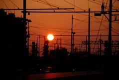 Заход солнца железной дороги и станции Стоковая Фотография RF