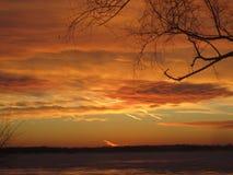 Заход солнца зимы над островом Мичиганом Grosse Стоковая Фотография RF