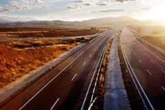 Заход солнца и ландшафт дороги Стоковое Изображение RF
