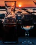 Заход солнца и вино Стоковые Изображения