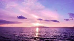 Заход солнца и вода Стоковая Фотография RF