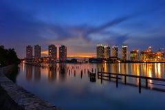 Заход солнца и город Стоковые Изображения