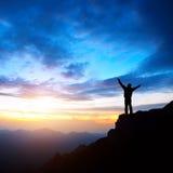 Заход солнца и горы сумрака Стоковая Фотография
