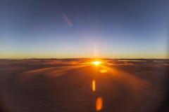 Заход солнца или восход солнца от самолета Стоковое Изображение RF