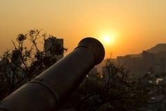 Заход солнца и канон на Fortaleza Do Monte в Макао, Китае Стоковые Фотографии RF