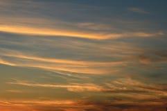 Заход солнца и красные облака стоковая фотография rf