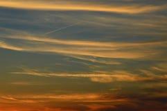 Заход солнца и красные облака Стоковые Изображения RF