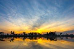 Заход солнца и небо облака Стоковые Изображения RF