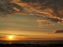 Заход солнца и облака апельсина Стоковые Изображения