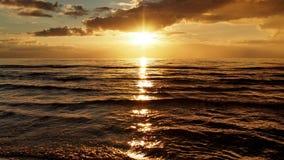 Заход солнца и облака над морем Стоковое Фото