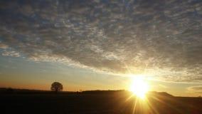Заход солнца и облака Стоковое Изображение RF
