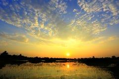 Заход солнца и облако Стоковые Фото