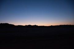Заход солнца и поднимать луны Стоковая Фотография RF