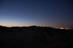 Заход солнца и поднимать луны Стоковая Фотография