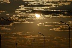 Заход солнца и предпосылки облаков Стоковые Фото